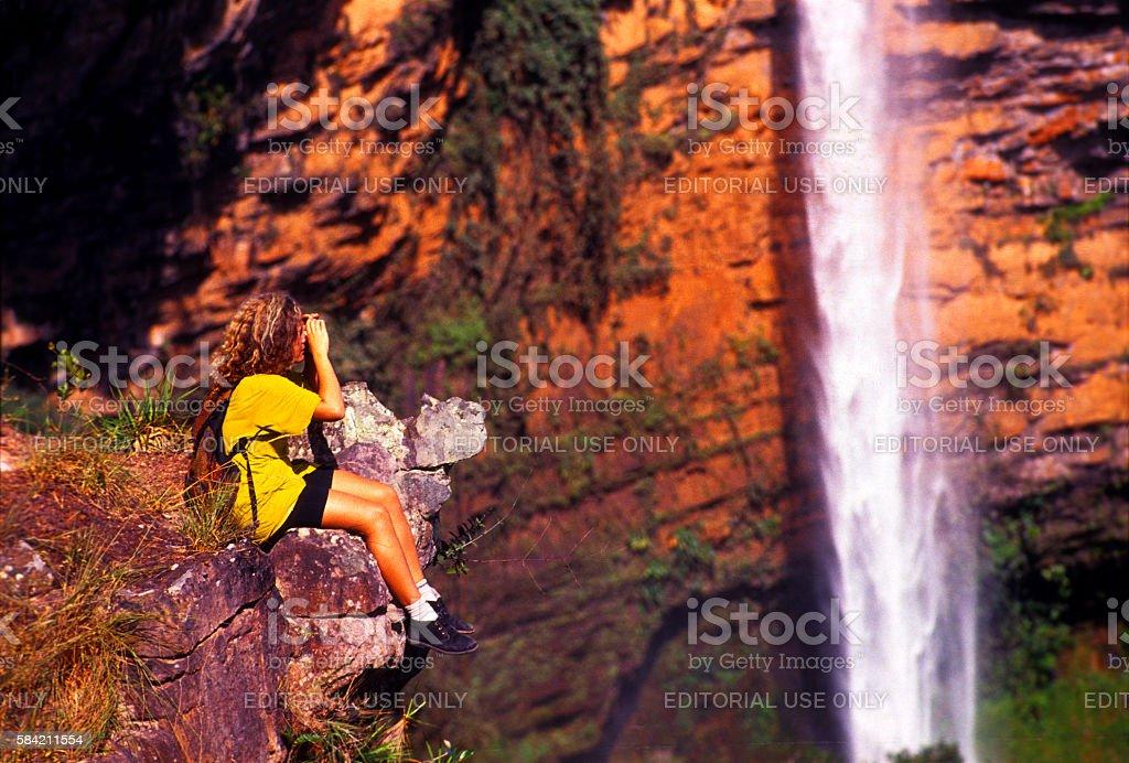 Tourist taking pictures of 'Véu de Noiva' waterfall, Brazil stock photo