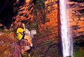 Tourist taking pictures of 'Véu de Noiva' waterfall, Brazil