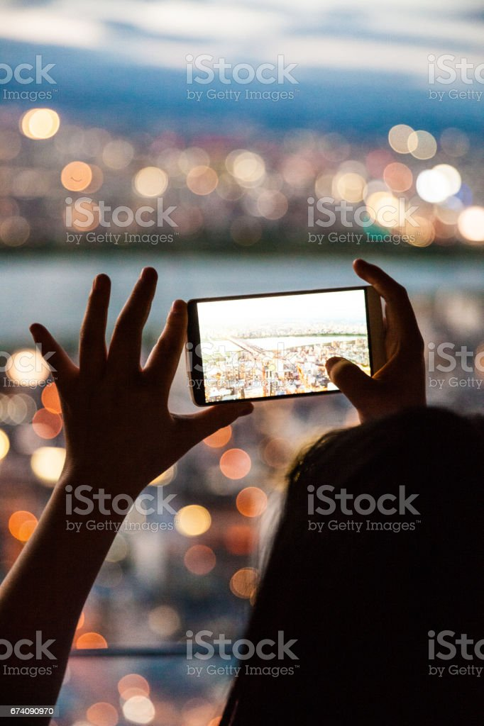Tourist taking pictures to city skyline stock photo