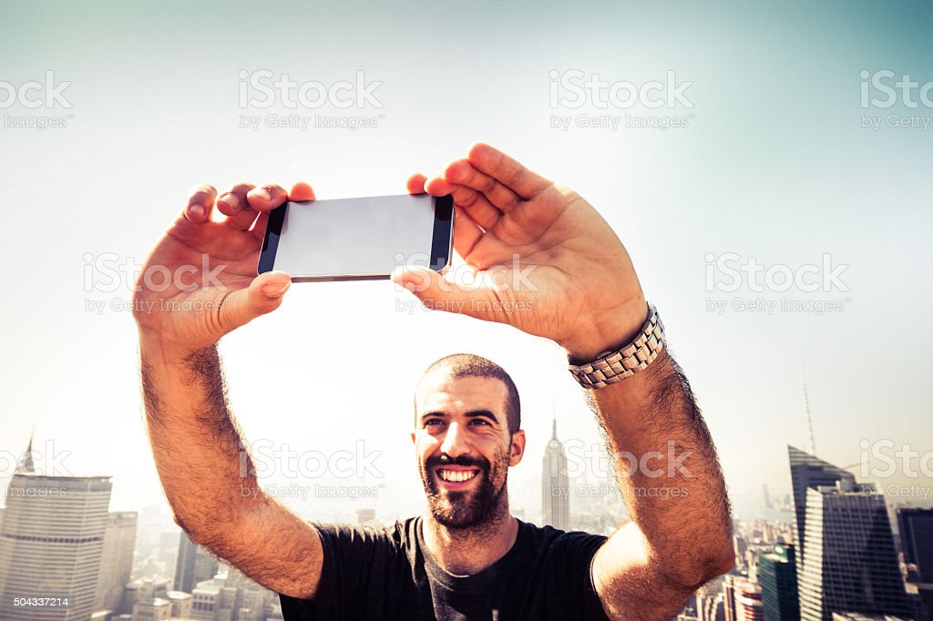 Tourist taking pictures to New York Skyline stock photo