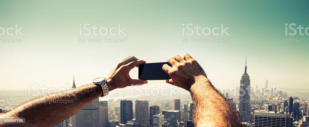 Tourist taking pictures to New York Skyline stock photo