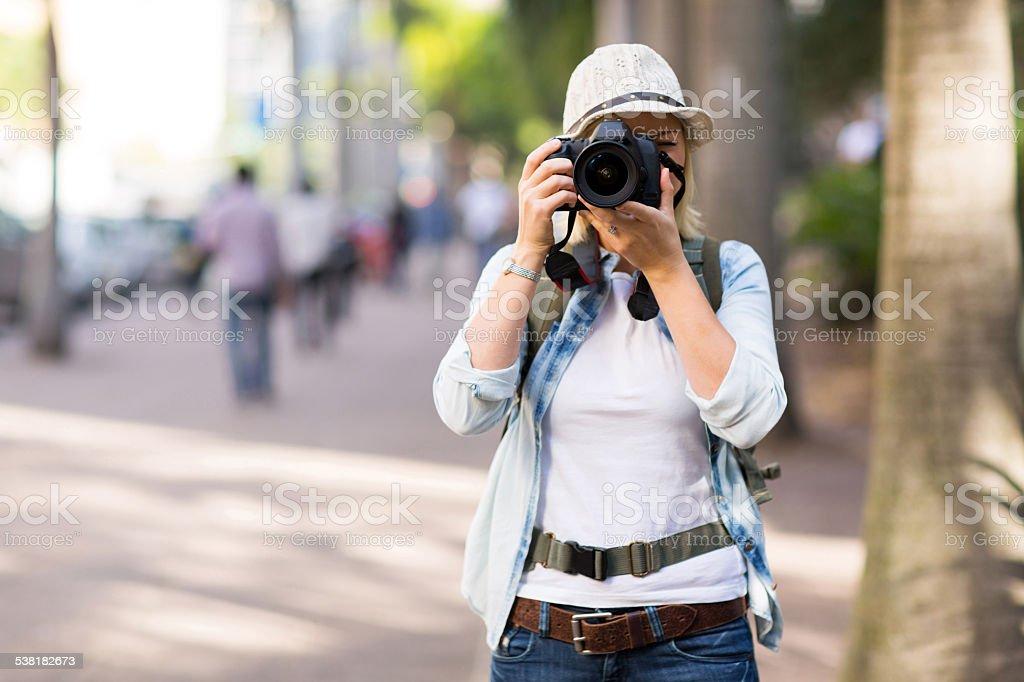 tourist taking street photos stock photo