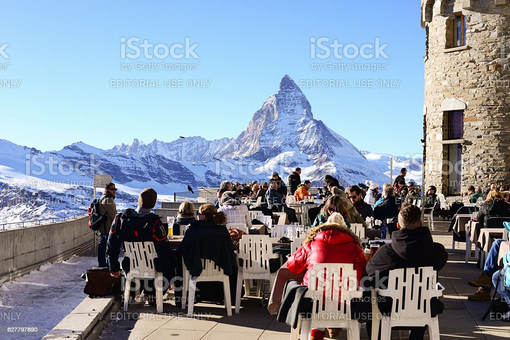 Tourist taking view of Matterhorn in winter stock photo
