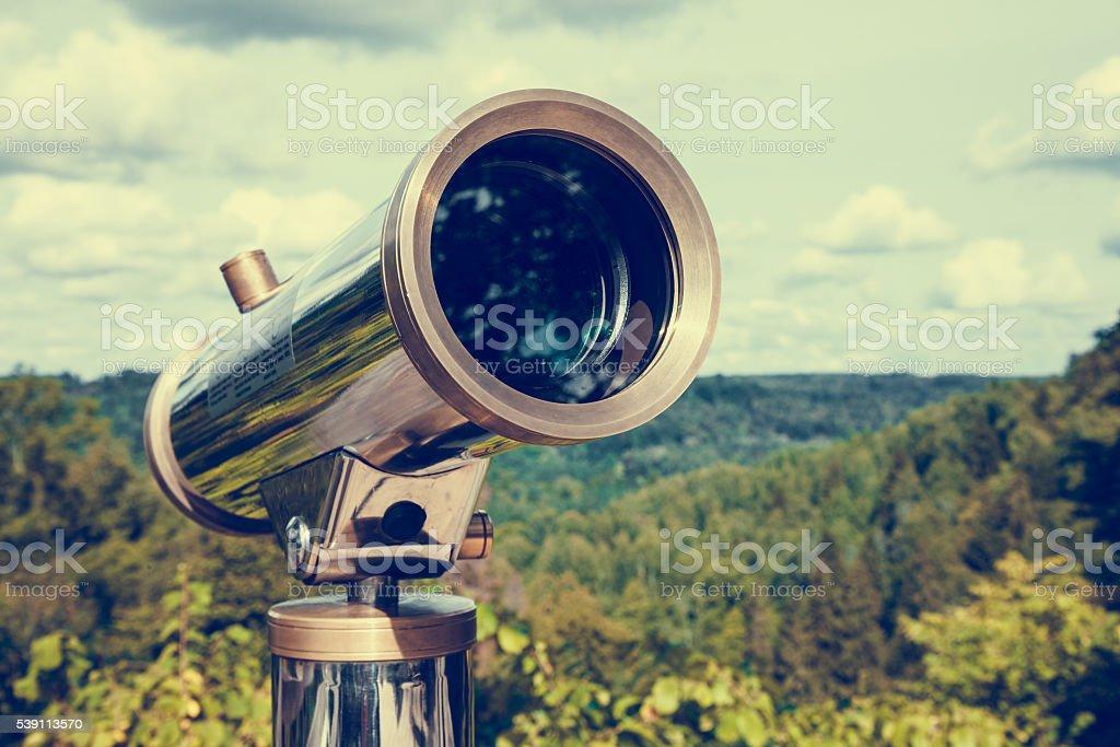 Tourist telescope for landscape exploring. stock photo