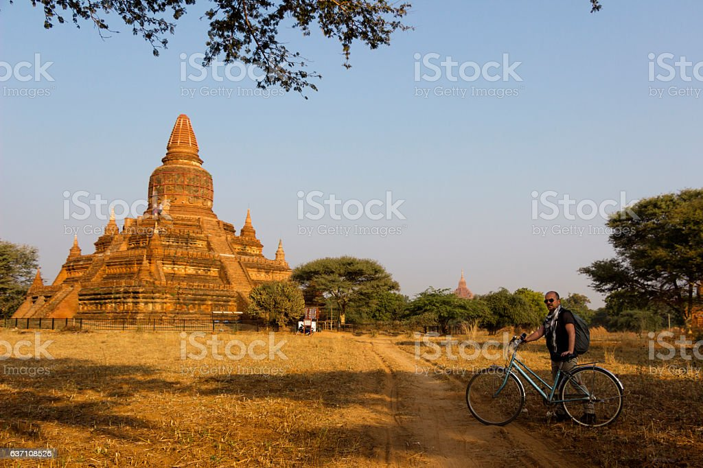 Tourist temples visiting by bicycle stock photo