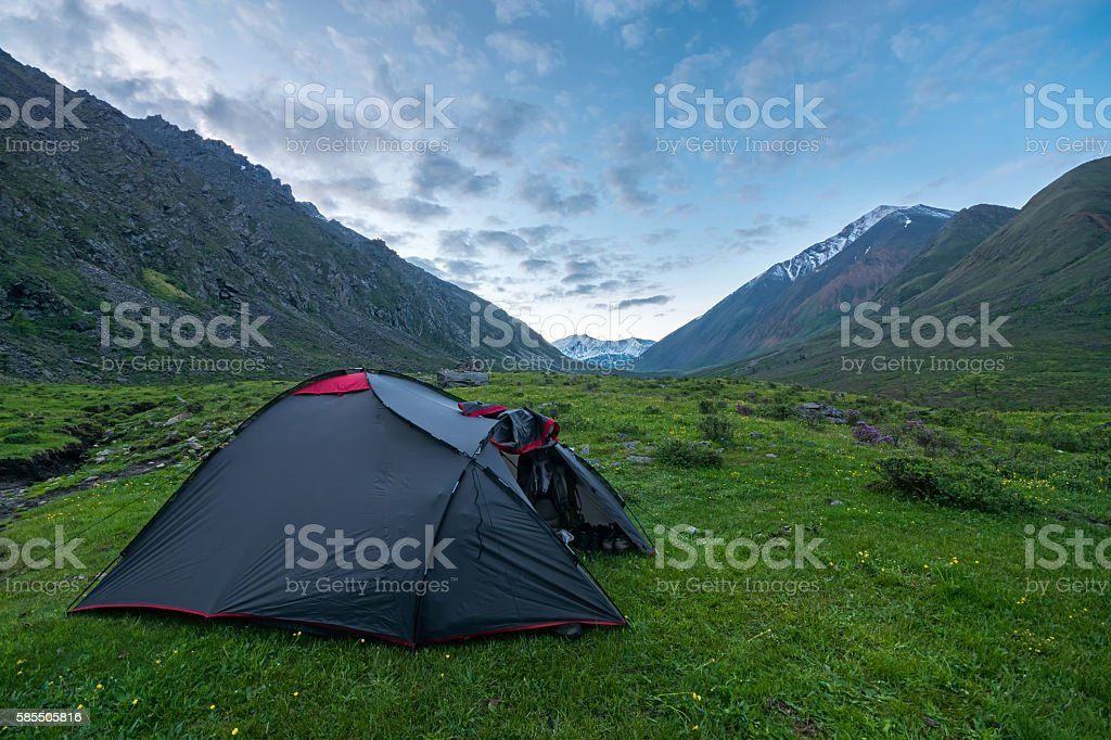 tourist tent in the mountains stock photo