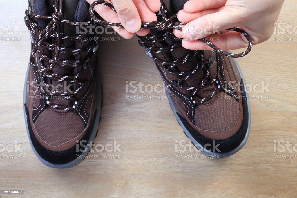 Tourist tie shoelaces from above stock photo