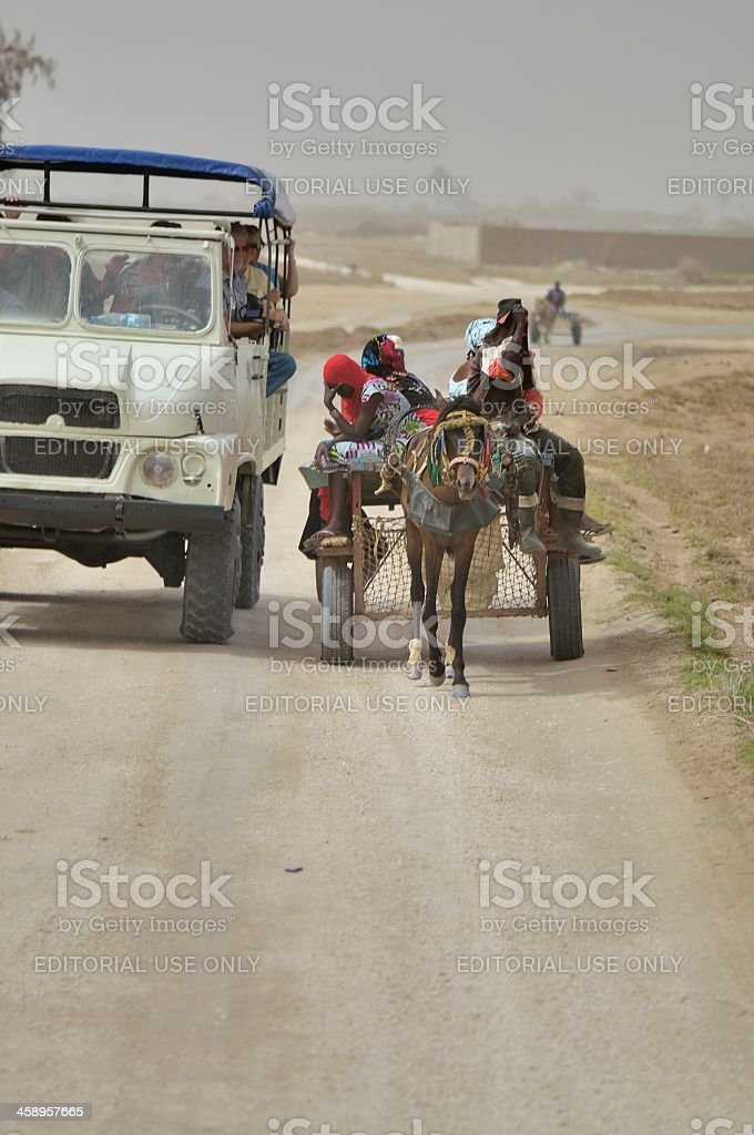 Tourist Transport Passing Salt Workers royalty-free stock photo