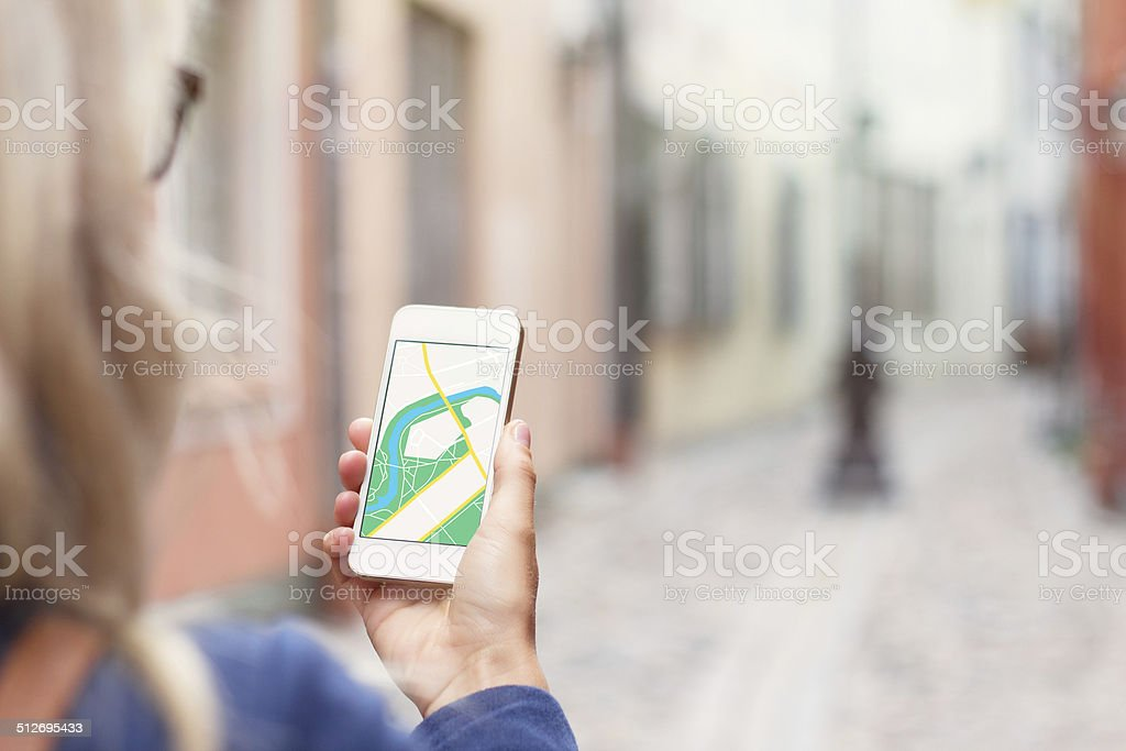 Tourist using navigation app on the mobile phone stock photo