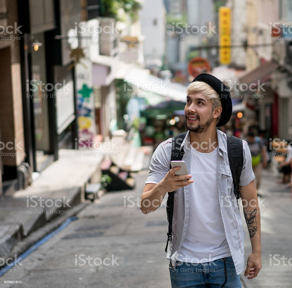 Tourist using the GPS on his phone stock photo