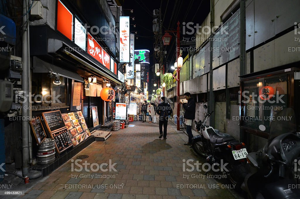 Tourist visit narrow pedestrian street known as as Yakatori alley stock photo