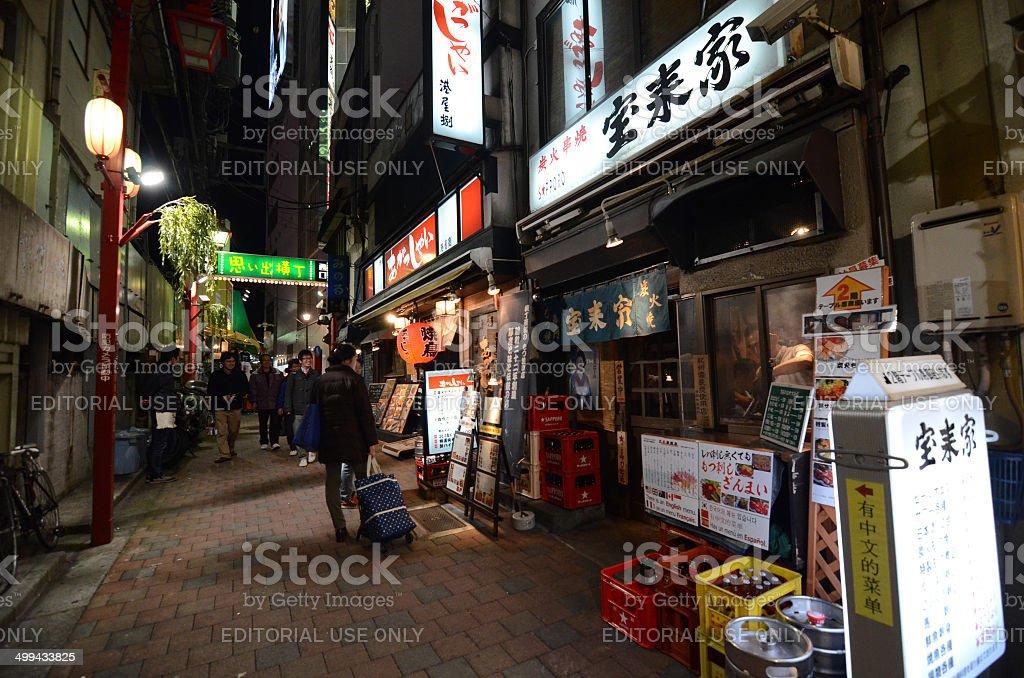 Tourist visit narrow pedestrian street known as Yakatori alley stock photo