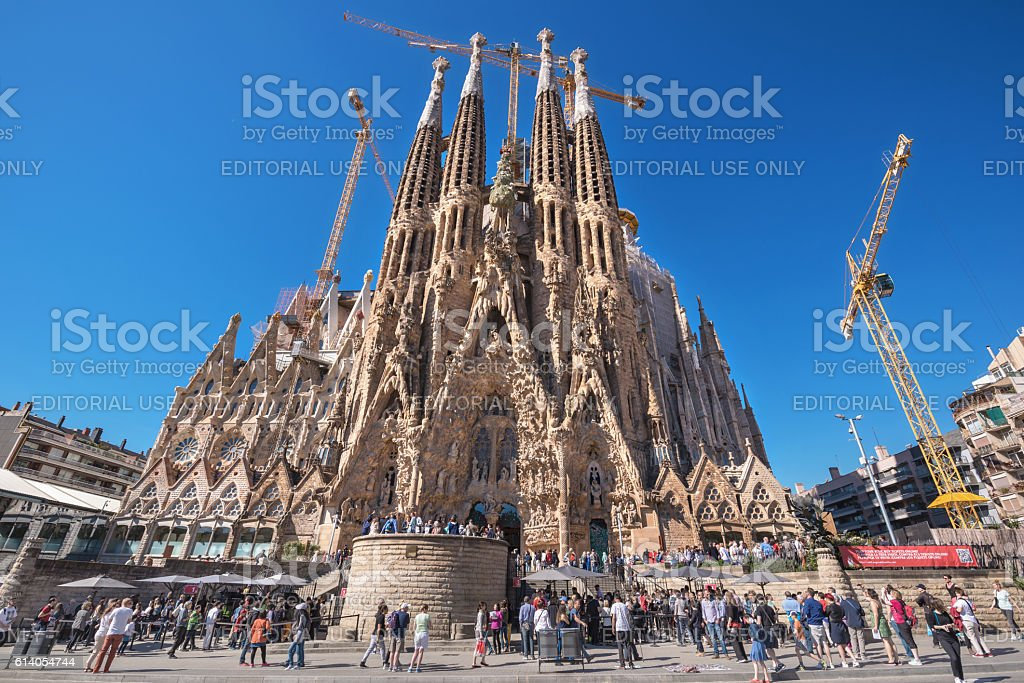 Tourist visiting Cathedral of La Sagrada Familia in Barcelona, Spain. stock photo