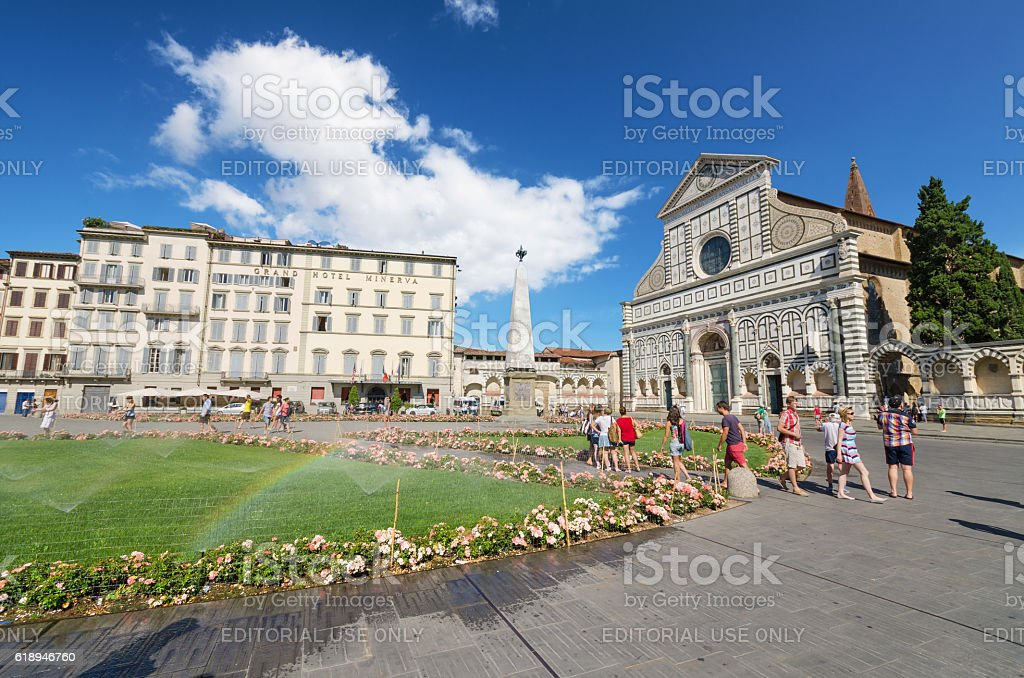 Tourist visiting famous Basillica Santa Maria Novella Florence, Italy. stock photo