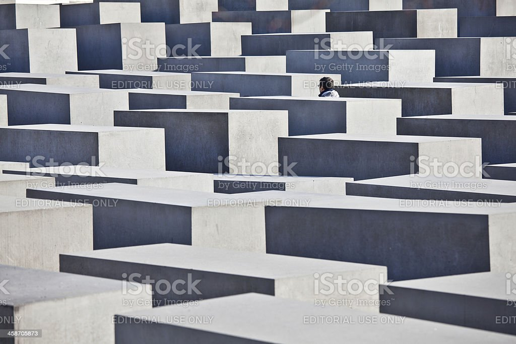 Tourist Visiting Holocaust Memorial in Berlin, Germany stock photo