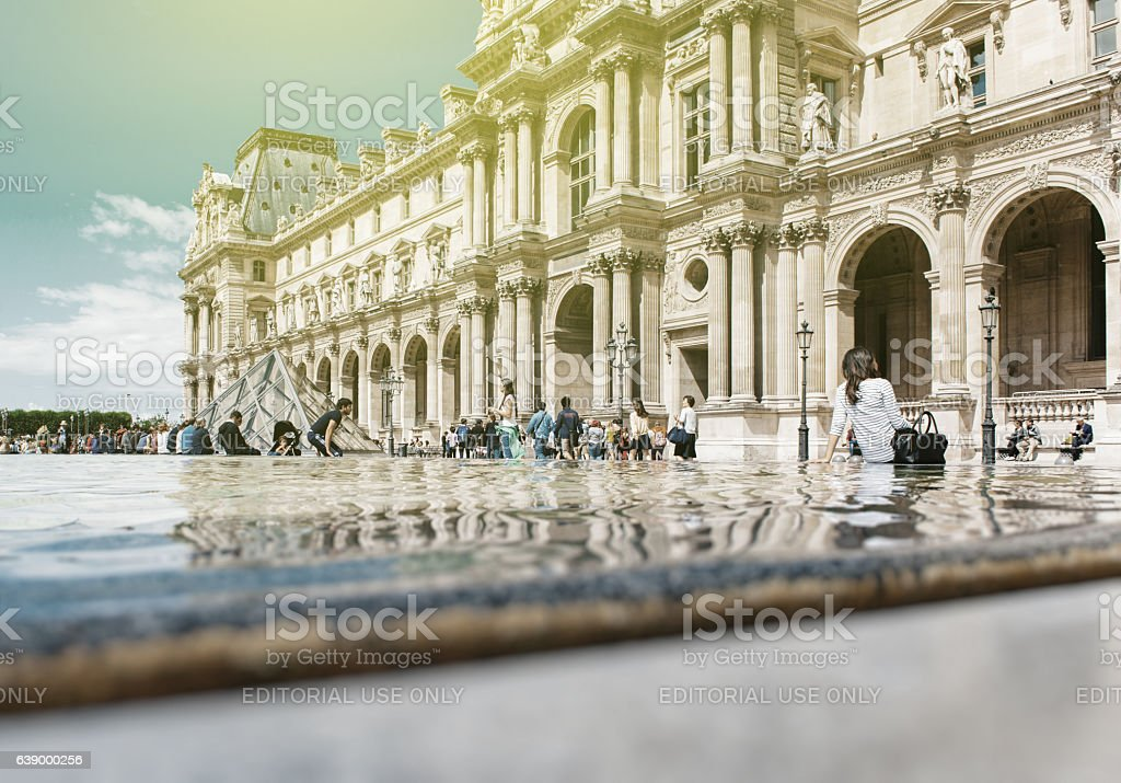 Tourist visiting Louvre, Paris sightseeing stock photo