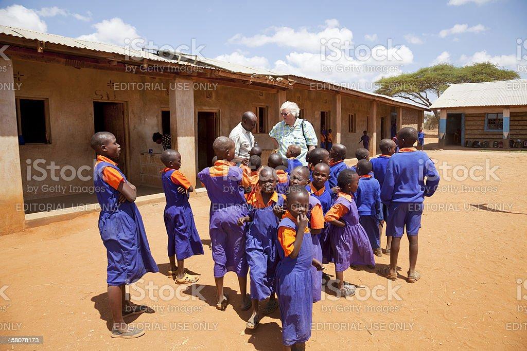 Tourist visiting Maasai school in Amboseli, Kenya stock photo