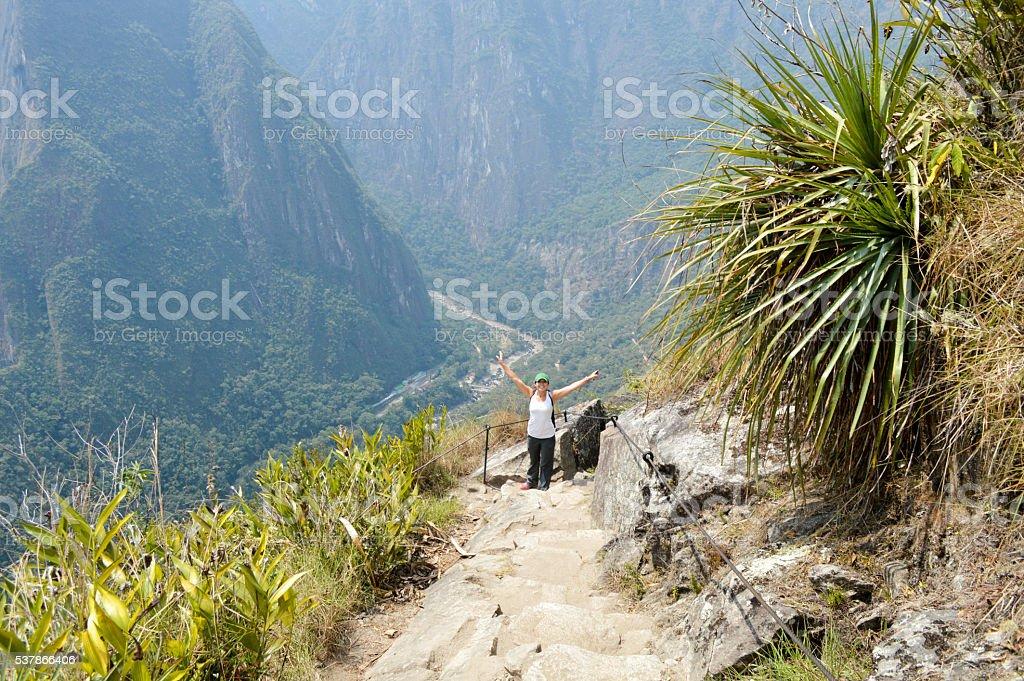 Tourist visiting Machu Picchu ruins in Peru stock photo