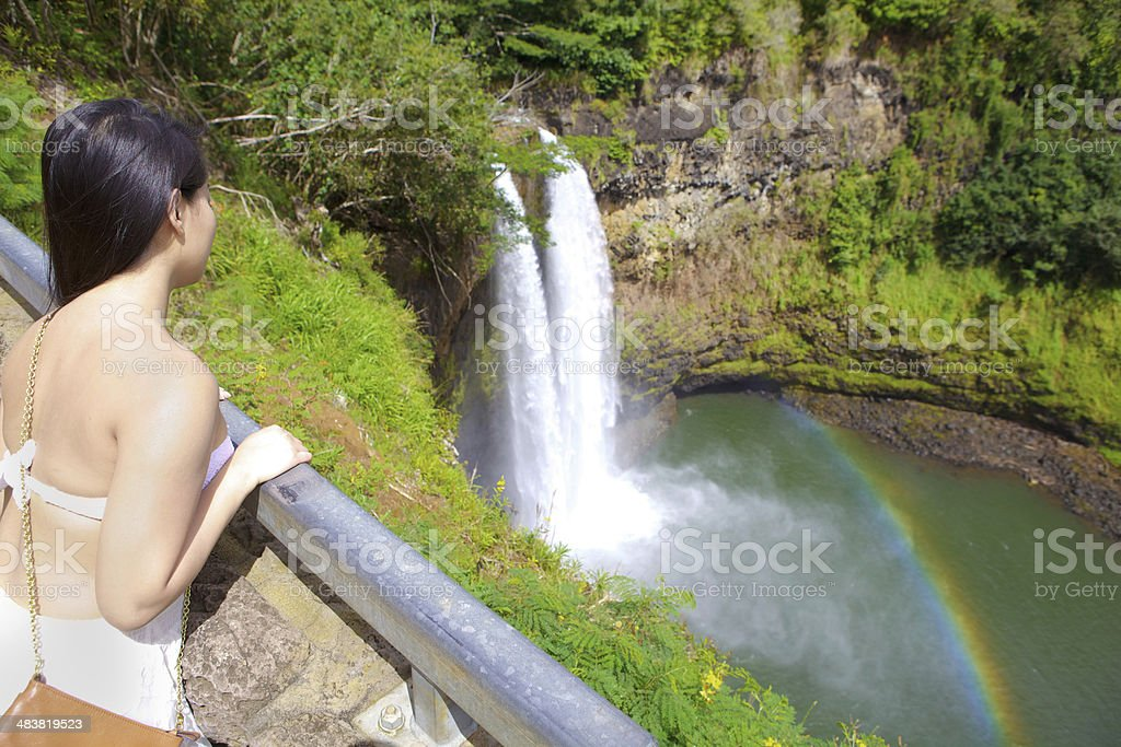 Tourist Visiting the Wailua Falls of Kauai Hawaii stock photo