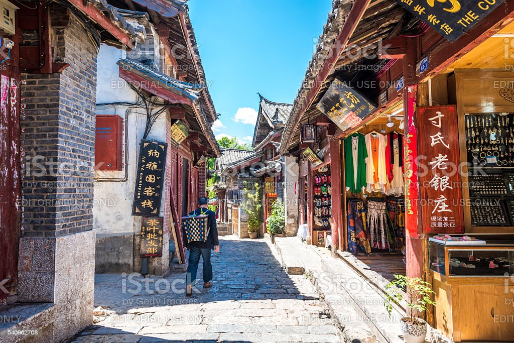Tourist walk along the street of Lijiang Old Town stock photo