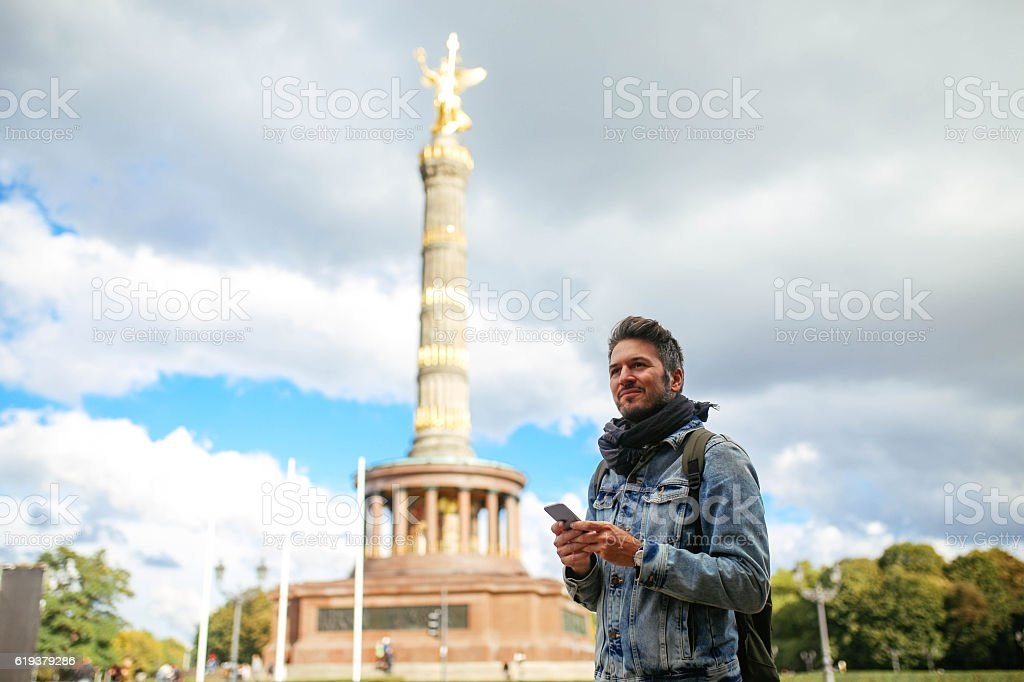 Tourist walking by the Berlin Victory column stock photo
