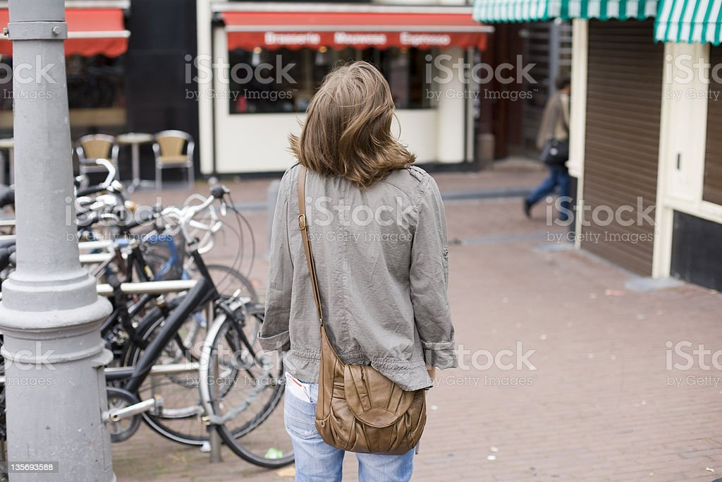 tourist walking in amsterdam stock photo