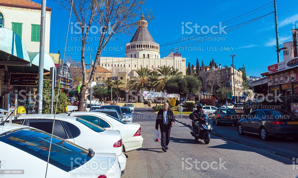 Tourist walking near Facade of Annunciation Cathedral stock photo