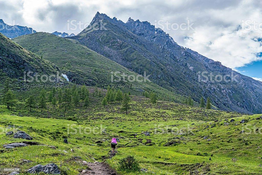 tourist walking on the trail in tunka range stock photo