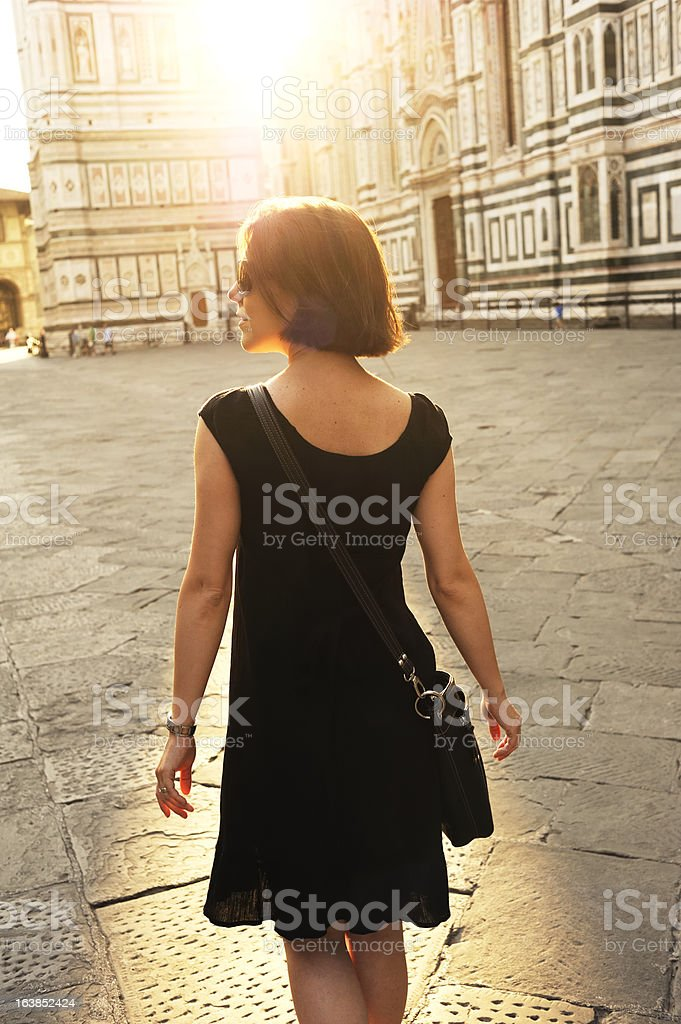 Tourist Walks on the Piazza Del Duomo in Florence stock photo