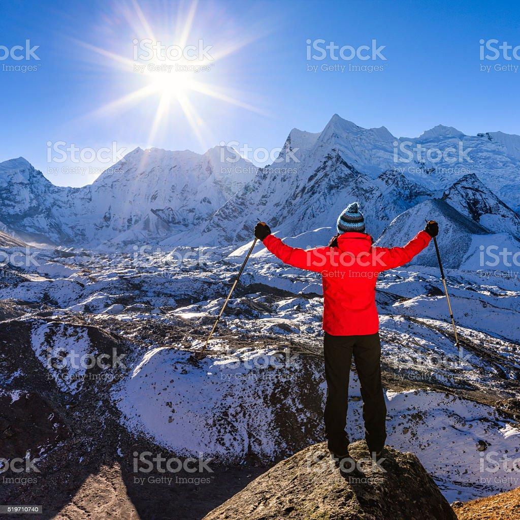 Tourist watching sunrise over Himalayas, Nepal stock photo
