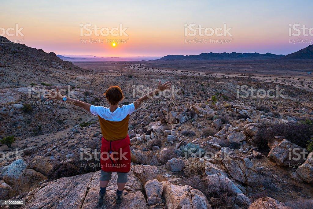 Tourist watching sunset over the Namib desert, Africa stock photo