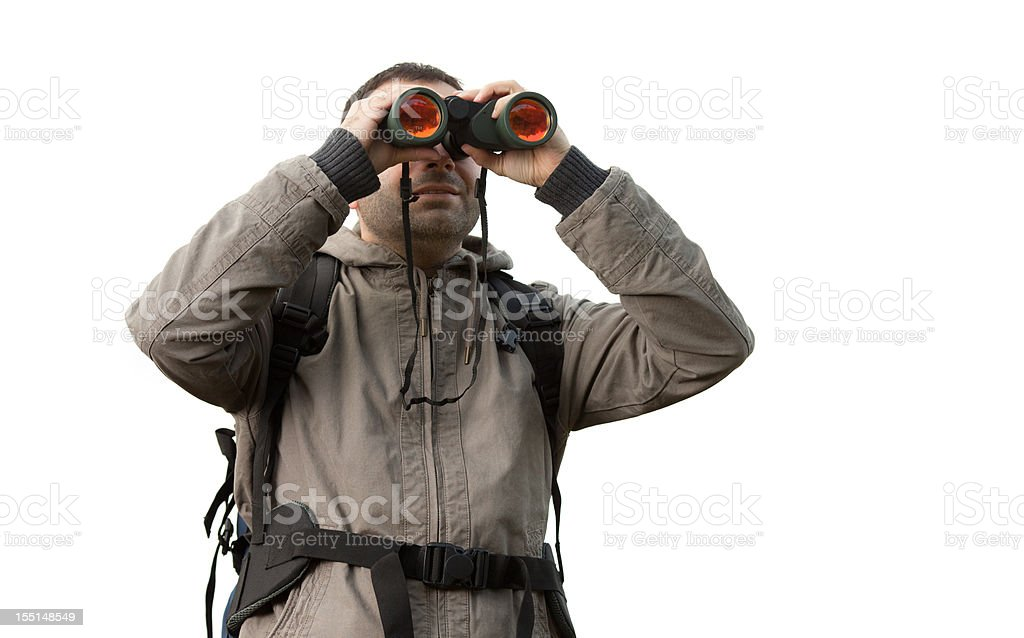 Tourist with a backpack and binoculars stock photo