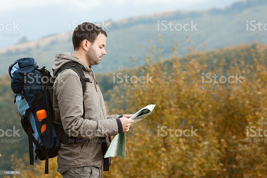 Tourist with a backpack in the mountains royalty-free stock photo