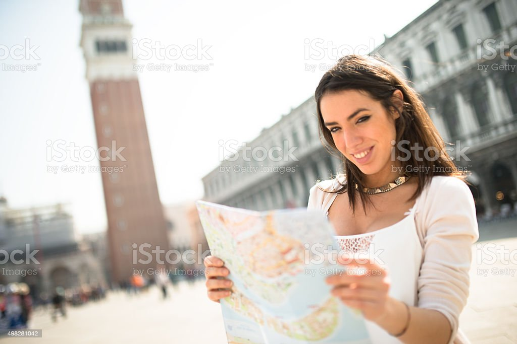 tourist with a map in Venice in st. mark square stock photo