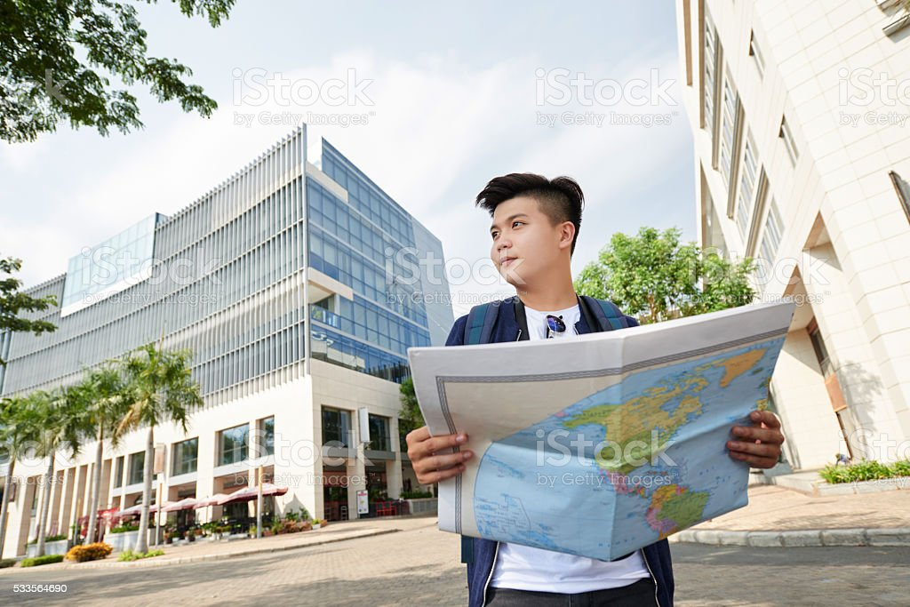 Tourist with a map stock photo