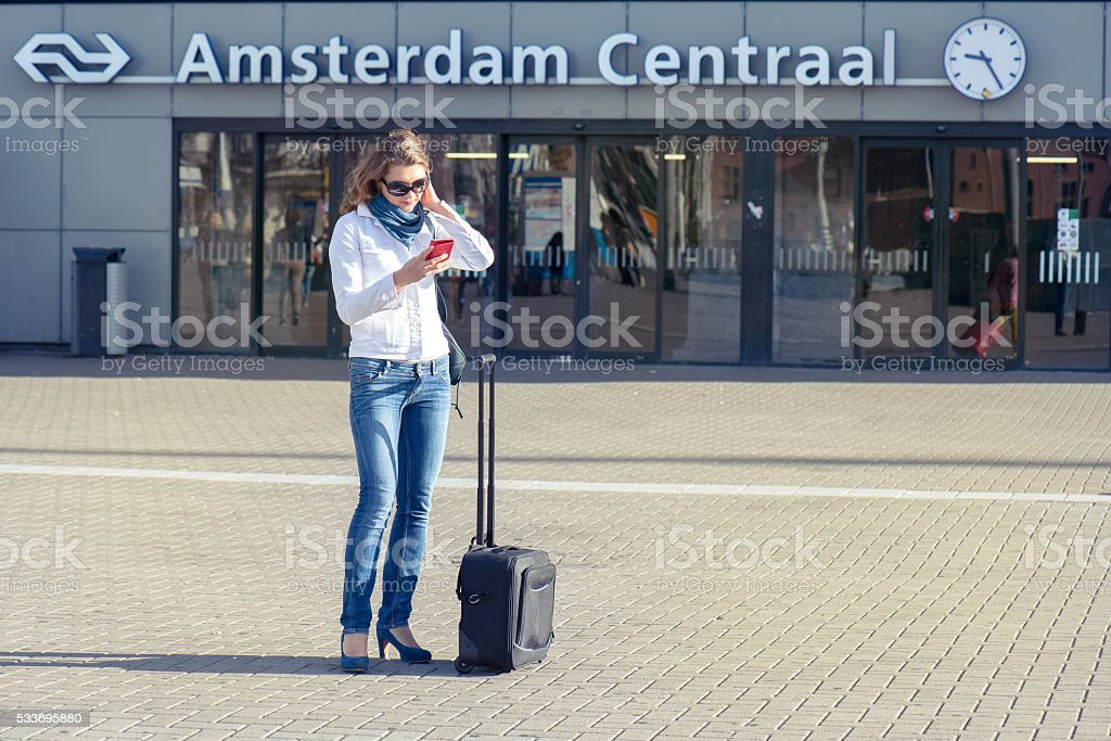 Tourist with a suitcase in Amsterdam stock photo