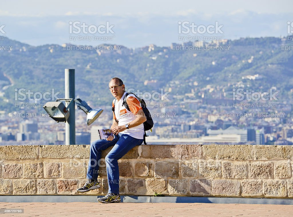 Tourist with Barcelona Guide in hands royalty-free stock photo