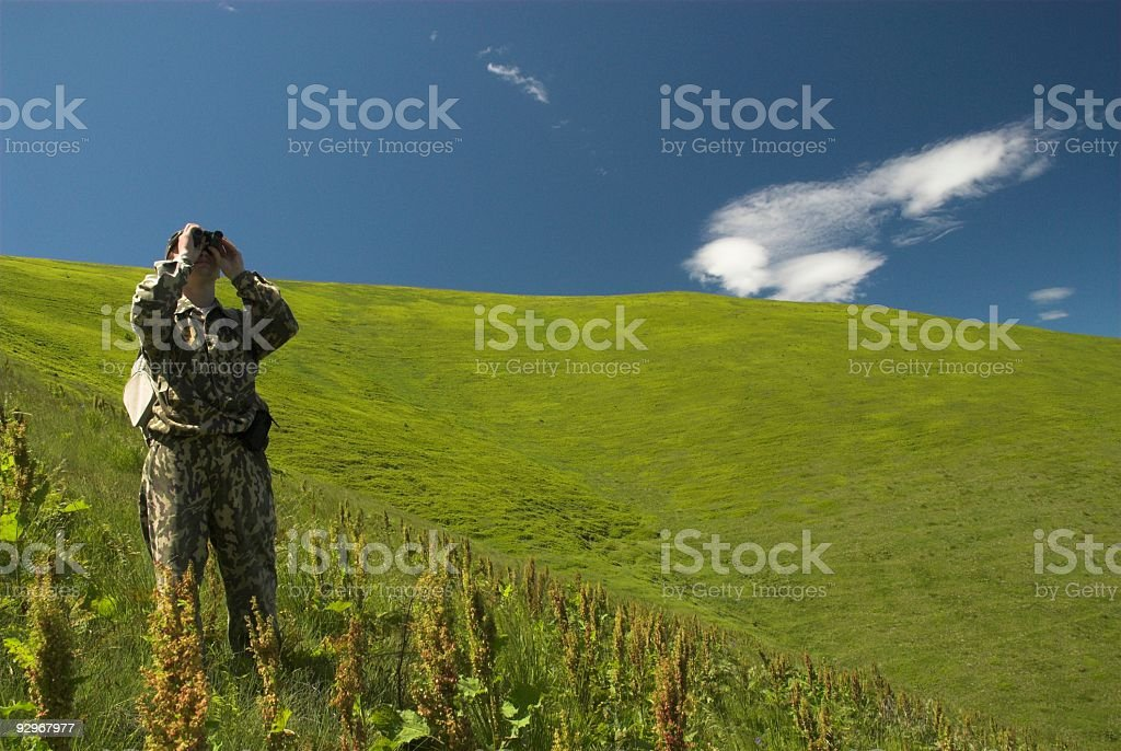 tourist with binoculars in mountains stock photo