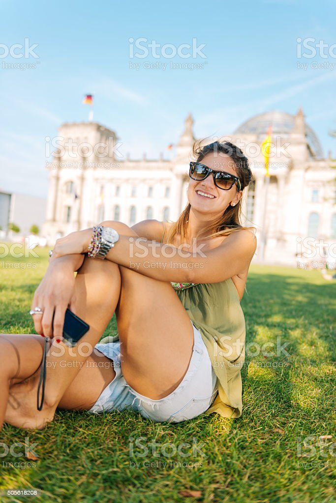 Tourist with camera in casual clothng sitting near German Parliament stock photo