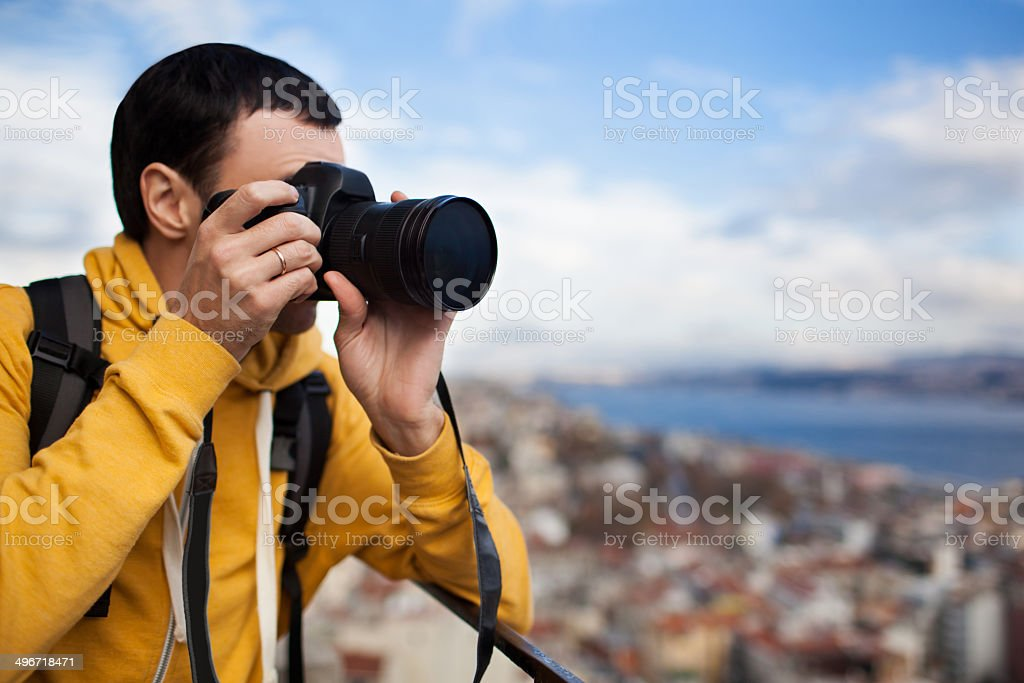 Tourist with camera take a picture. stock photo