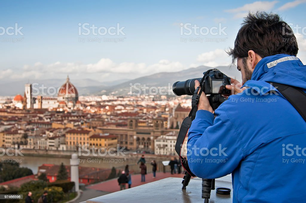 Tourist with Camera Taking a Picture of Florence, Italy royalty-free stock photo