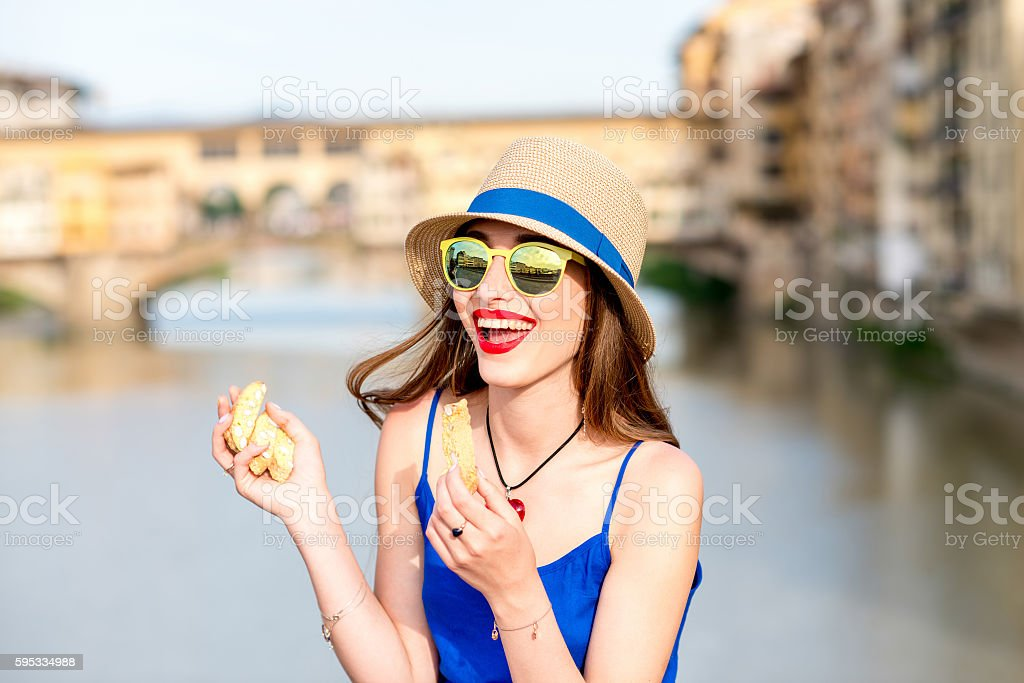 Tourist with cantuccini cookie in florence stock photo