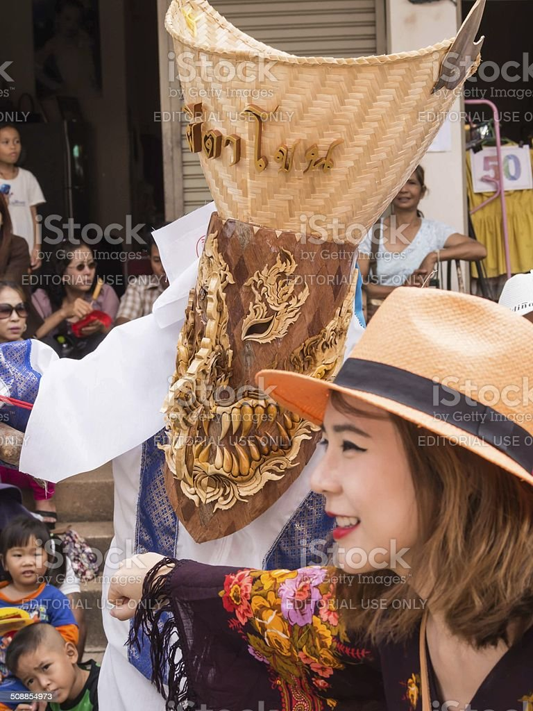 Tourist with colorful mask performer in Phi Ta Khon Festival stock photo