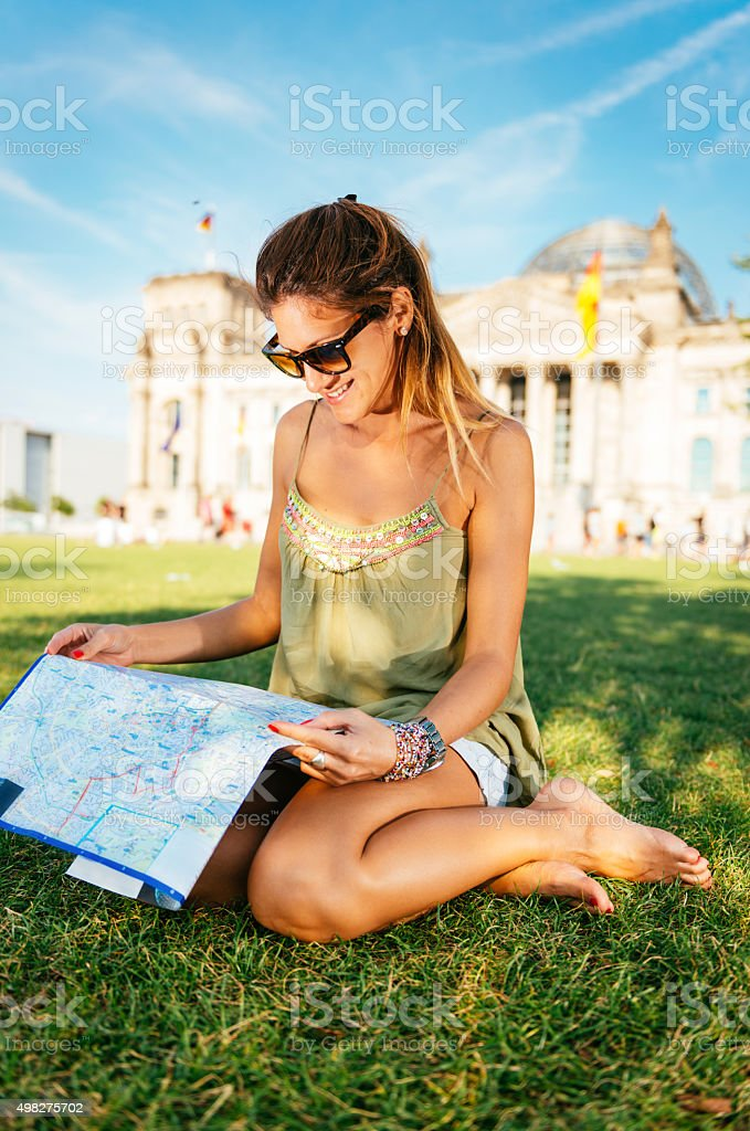Tourist with map and exploring famous landmarks in Berlin, Germany stock photo