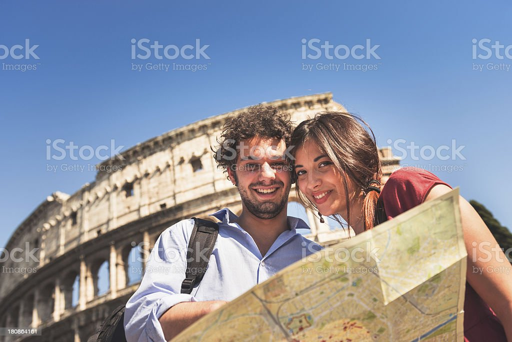 tourist with map at rome - coliseum stock photo