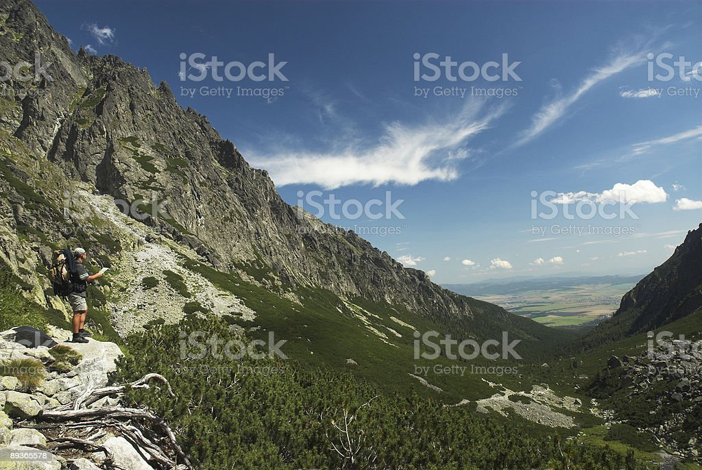 Tourist with map in mountains royalty-free stock photo