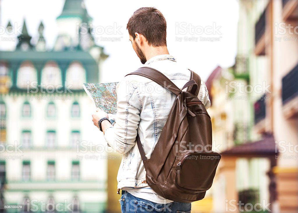 Tourist with map stock photo