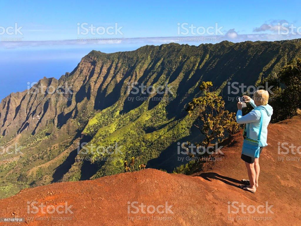 Tourist Woman at Waimea Canyon Kalalau Beach, Kauai, Hawaii stock photo