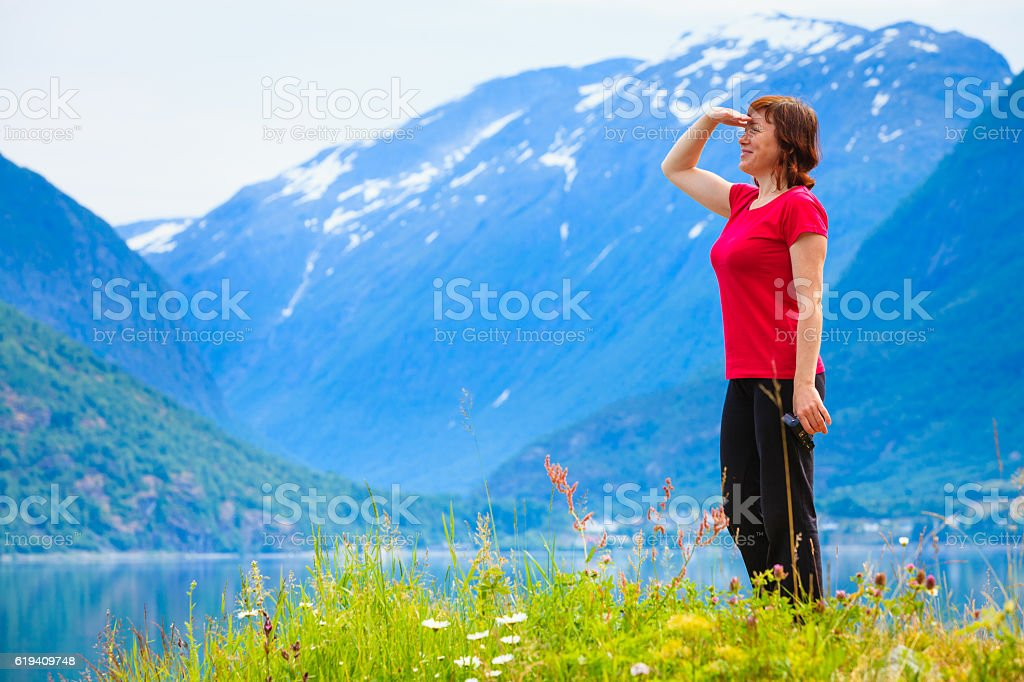 Tourist woman enjoying fjord view in Norway stock photo