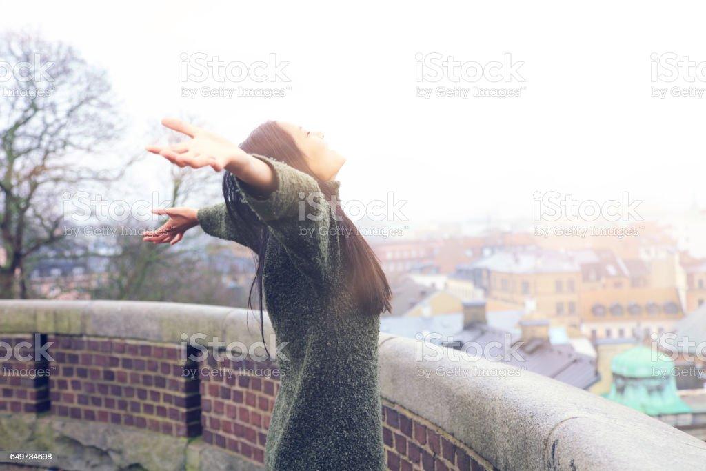 Tourist woman enjoys the trip; Kärnan castle in Helsingborg, Sweden stock photo
